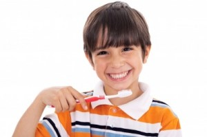 kid brushing his teeth